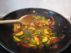 Fry the onion and peppers in spices